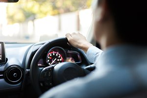 Close-up of Young man driving on the road