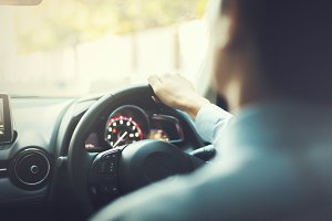 Close-up of Young man driving on the road - vintage tone