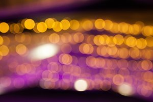 Purple and Orange Bokeh Light. Abstract Background for Christmas, Nightlife, Urban Life, Holiday