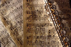 Flute on old  sheet music top right