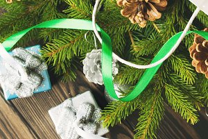 Gift bag with baubles and fir branches. Square