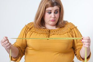 woman looking measuring tape