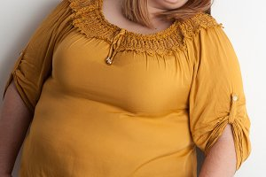 Worried overweight woman