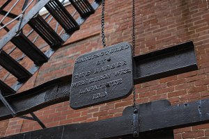 Iron staircase and plaque