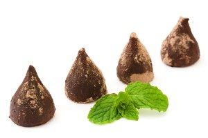 Homemade chocolate truffles and mint
