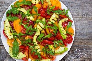Appetizer tomato, avocado, arugula