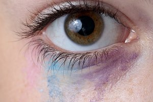 Eyes of a teenage girl with paint