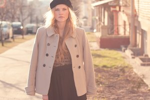 girl in a beret and coat