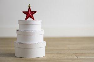Christmas star on white boxes
