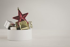 Red star with christmas gifts on unfocused background
