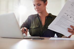 Young woman with documents