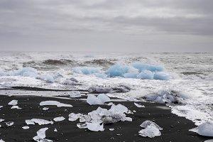 Black sand beach with ice