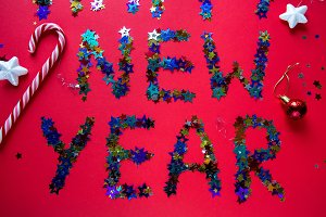 inscription colored stars new year on a red background