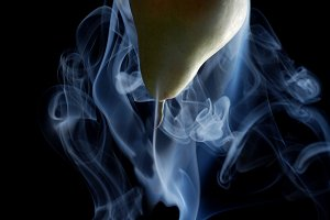 green pear enveloped by smoke
