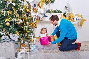 Father and daughter lay out gifts