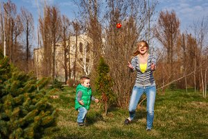 Mother and son play ball.