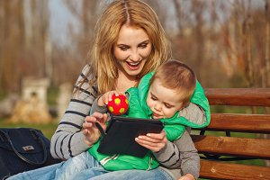 Mother, son playing with tablet pc