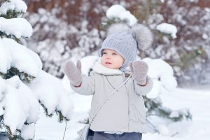 Little girl in winter park.