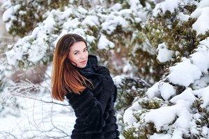 Pretty girl in a fur coat