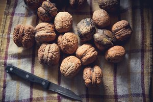 Walnuts and knife on the table