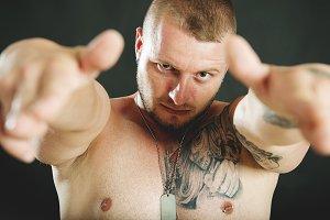 Tattooed brutal man