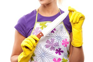 housewife in yellow rubber gloves