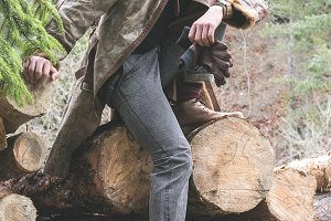 Young men on logs