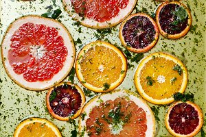 Ripe red oranges and grapefruits