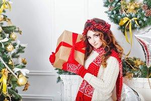 Girl hold Christmas present