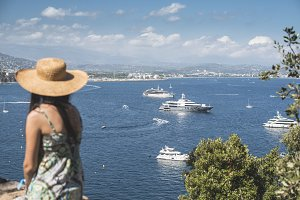 Woman watching yachts