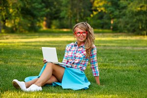 Girl with laptop smiling