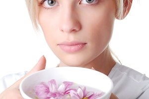 woman with bowl of flowers