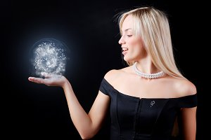 woman in black dress with sphere
