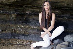 Cavern girl sitting in cavern