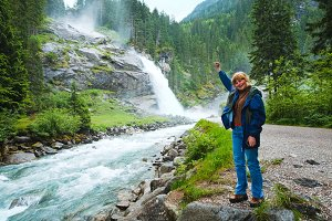 Woman near waterfall