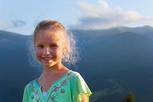 Girl in summer mountain