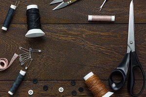 Tailor items on wooden.