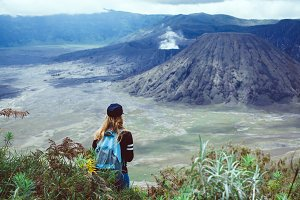 Travel girl see in volcano, backpack
