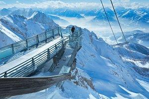Woman in winter Alps mountain
