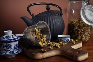 Chrysanthemum tea in a strainer