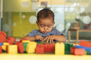 Baby playing with toy blocks.