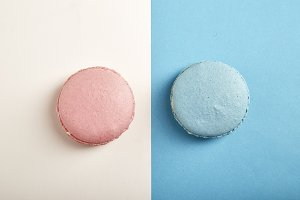 french colorful macarons on colorful background