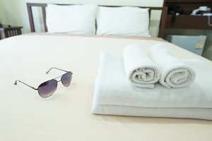 Towels placed on the bed.