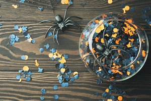 Halloween party confetti on dark background