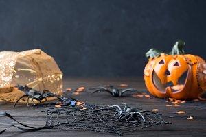Black background with Halloween symbols