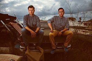 Men sitting on old retro car