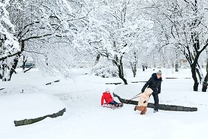 Happy family play in winter park