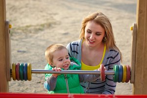 Mother and son on the playground