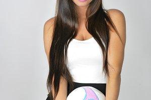 Soccer girl posing straight face