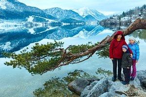 Family in winter Dolomite mountain
